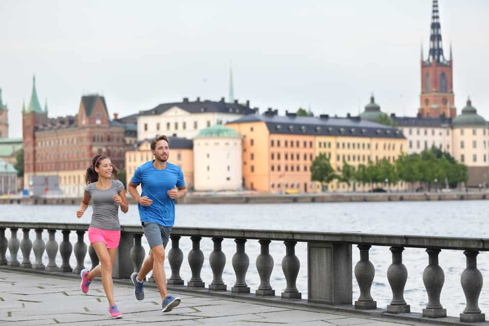 couple running in Stockholm. A decorative image for an article about travel workout ideas