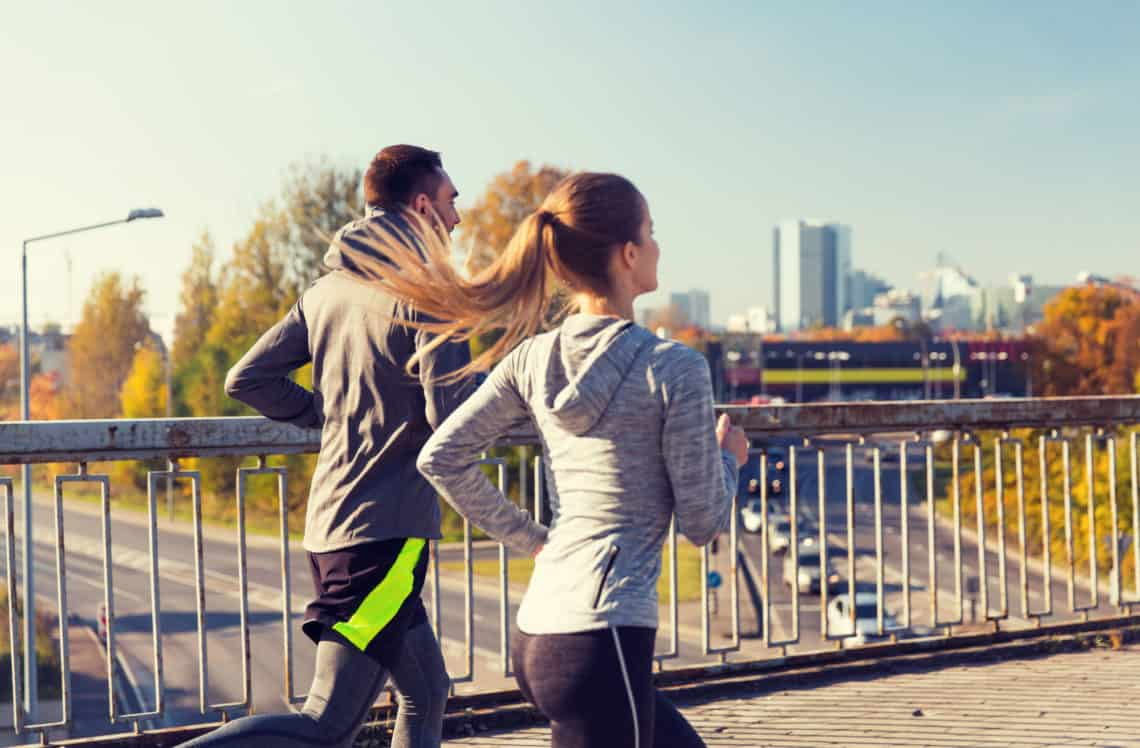 Fitness Sport People And Jogging Concept Happy Couple Running Outdoors Happy Couple Running Outdoors
