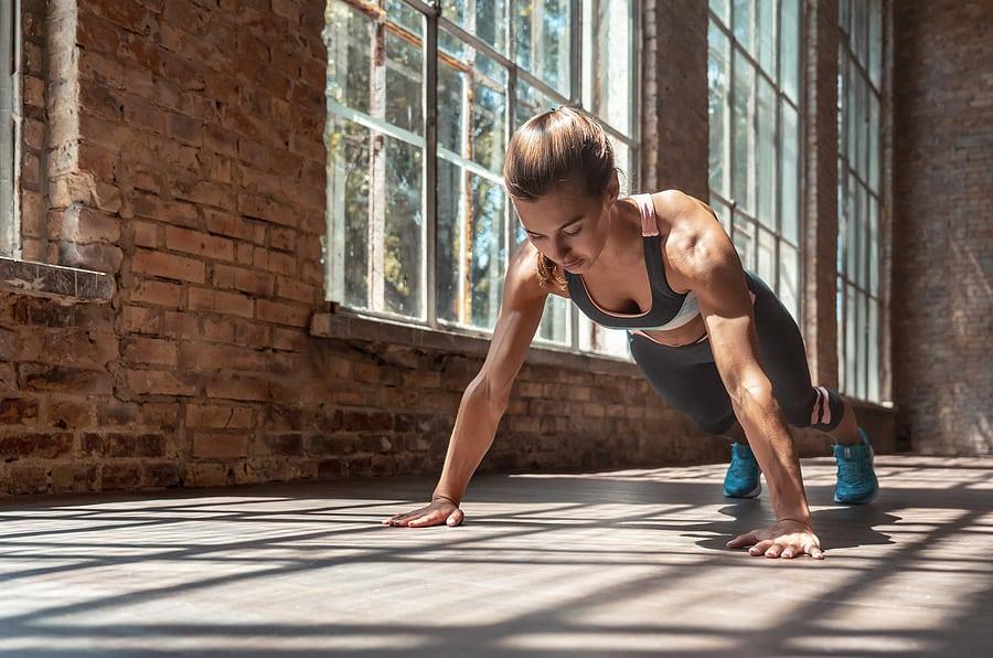 woman exercising doing planks improving body awareness for injury prevention