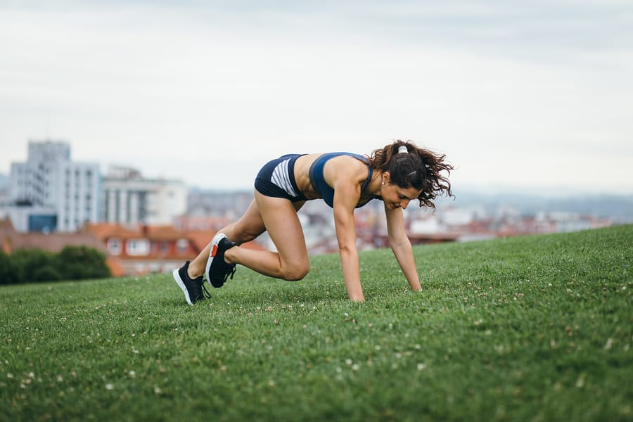 woman doing an interval training workout in a park