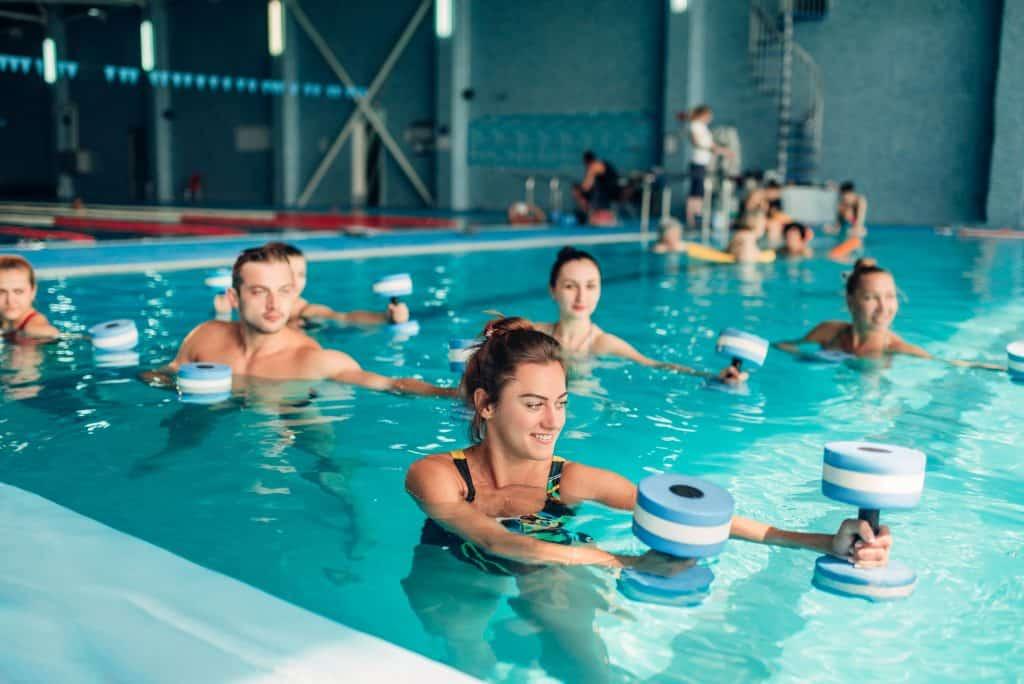 aquatic exercise class using aquatic exercise equipment