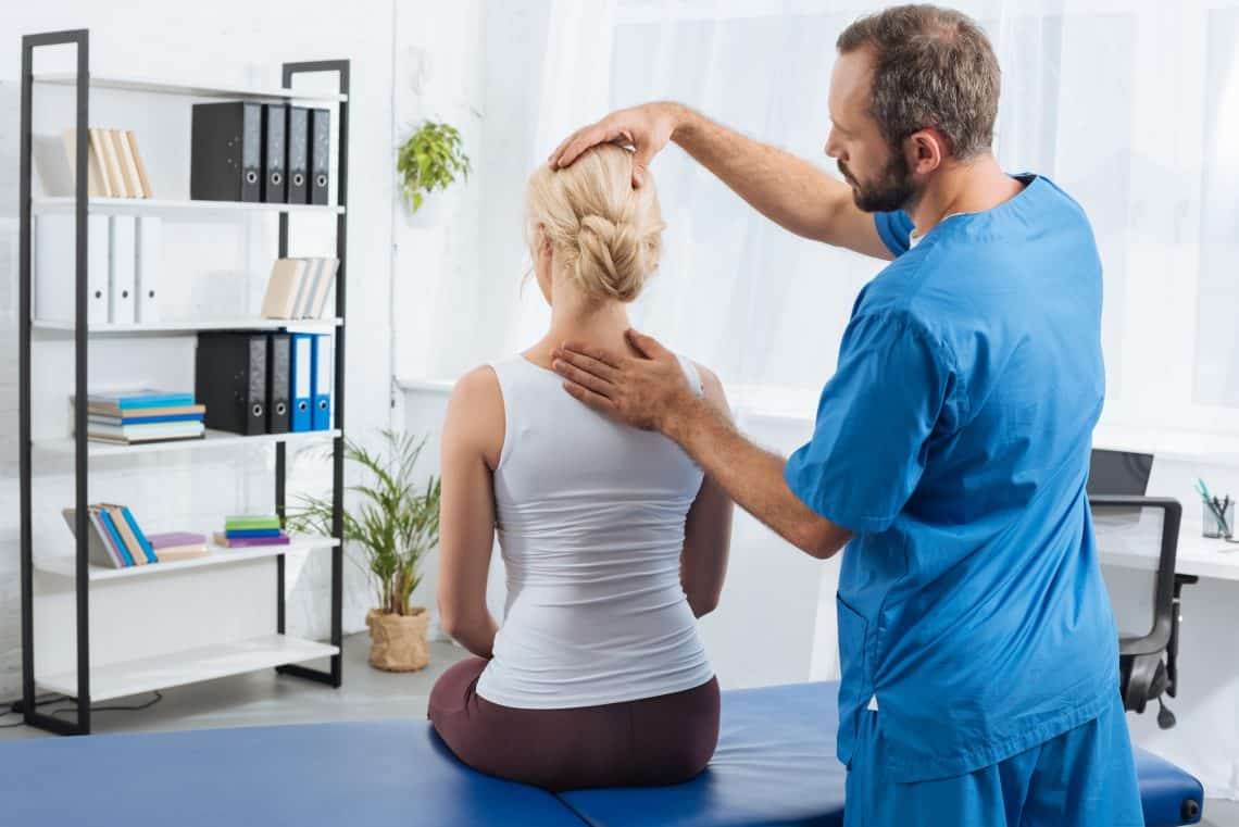 physical therapist evaluating a patient