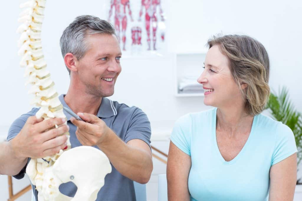 physical therapist providing patient education how to prepare for your first physical therapy appointment