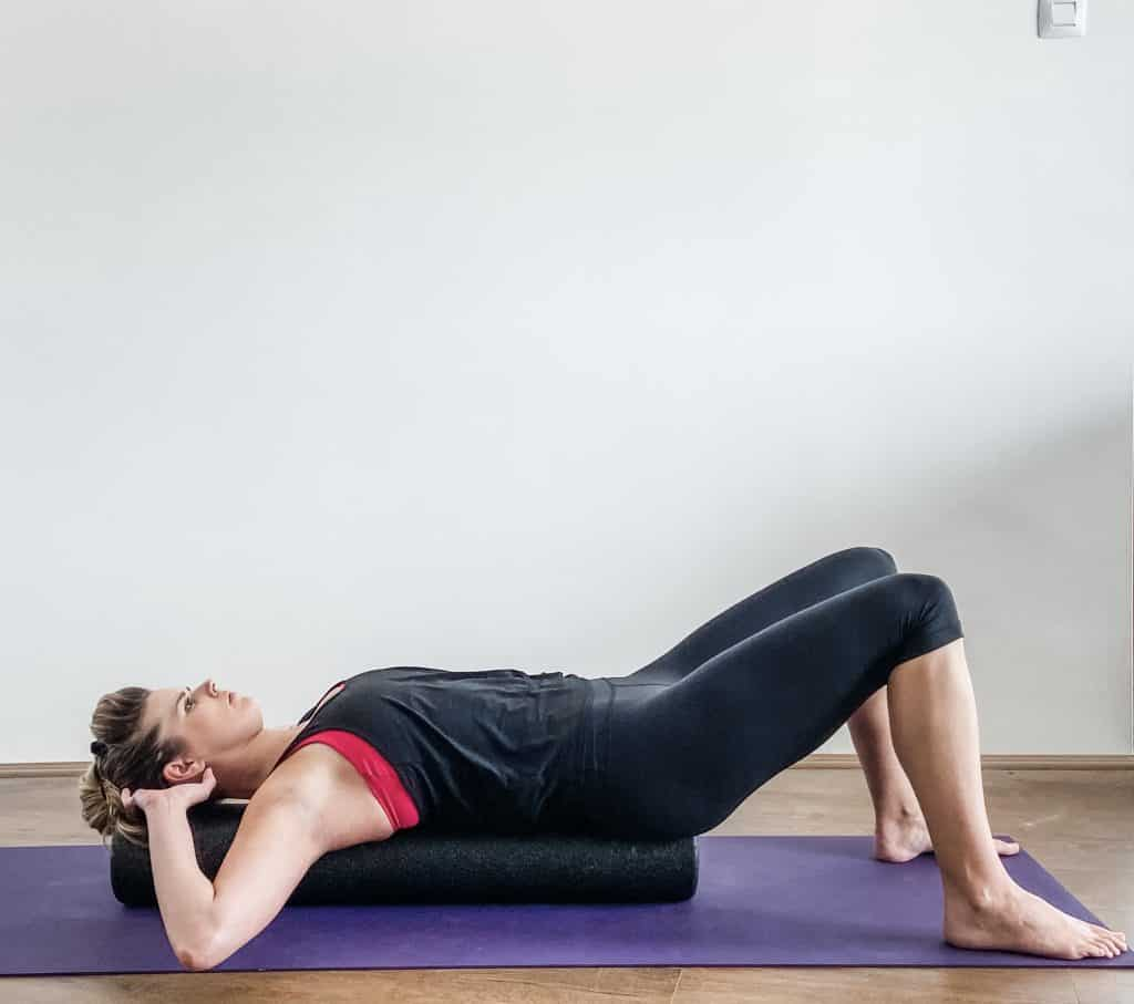 shoulder mobility on a foam roller to demonstrate different size foam rollers for how to choose a foam roller.