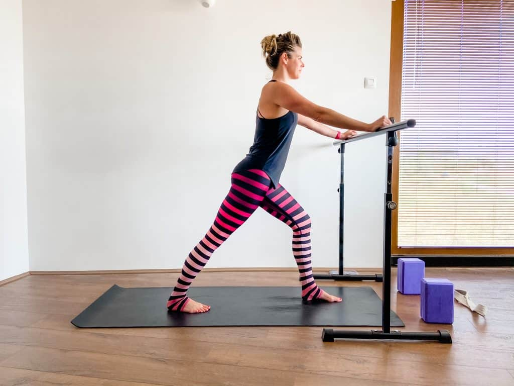 woman demonstrating a standing calf muscle stretch
