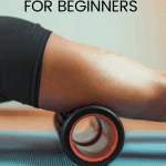 woman using a foam roller on her quad muscles with text overlay how to foam roll for beginners