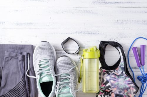 flat lay image of workout accessories, decorative image for an article about fitness essnetials