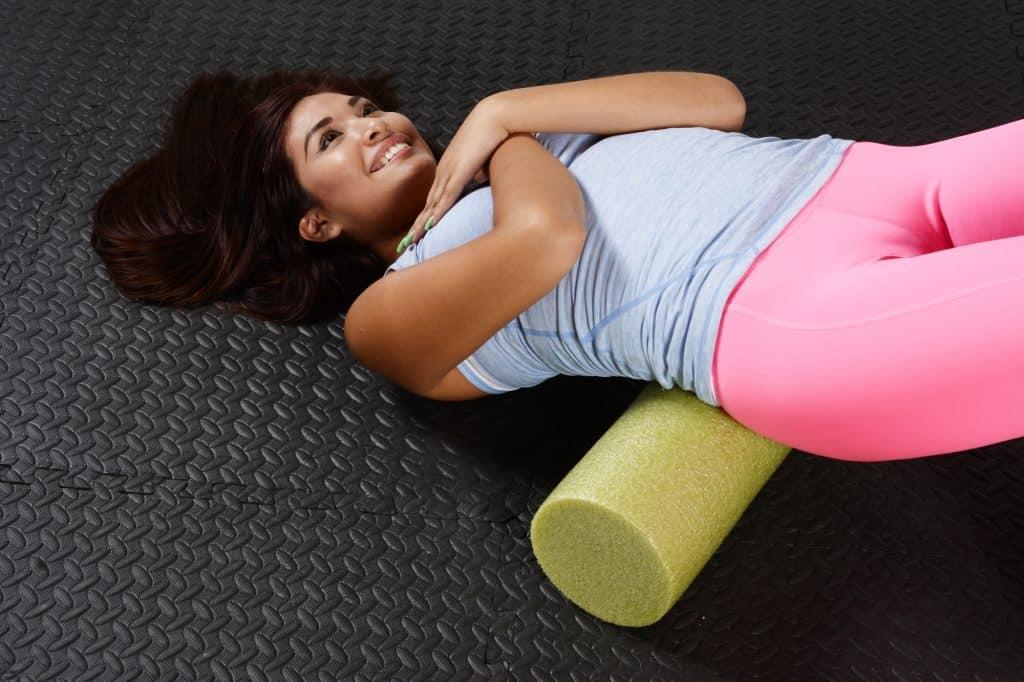 woman using a foam roller
