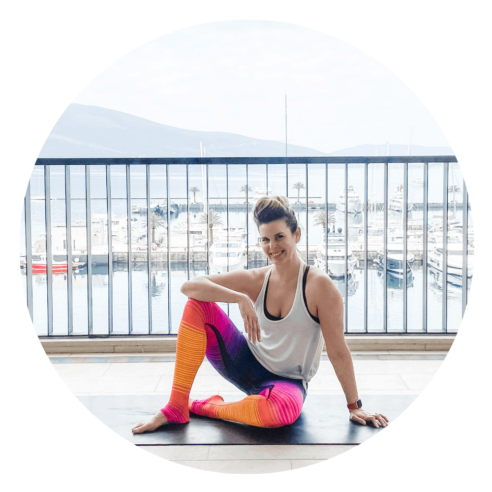 woman sitting on a yoga mat with ocean background