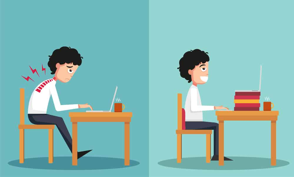cartoon image of a man working at a computer demonstrating good posture and bad posture