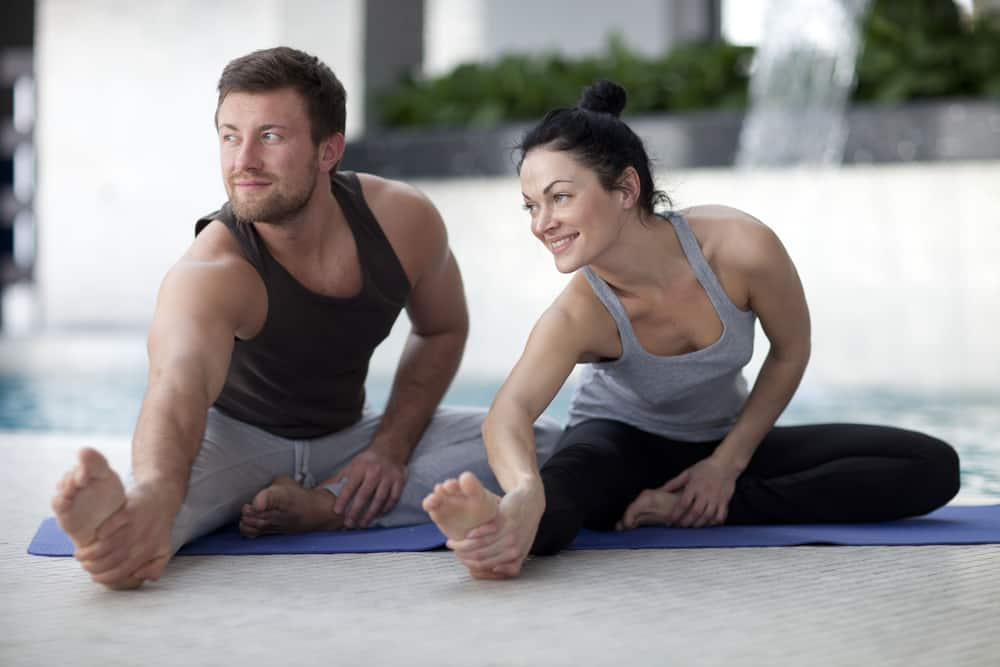 couple stretching during yoga