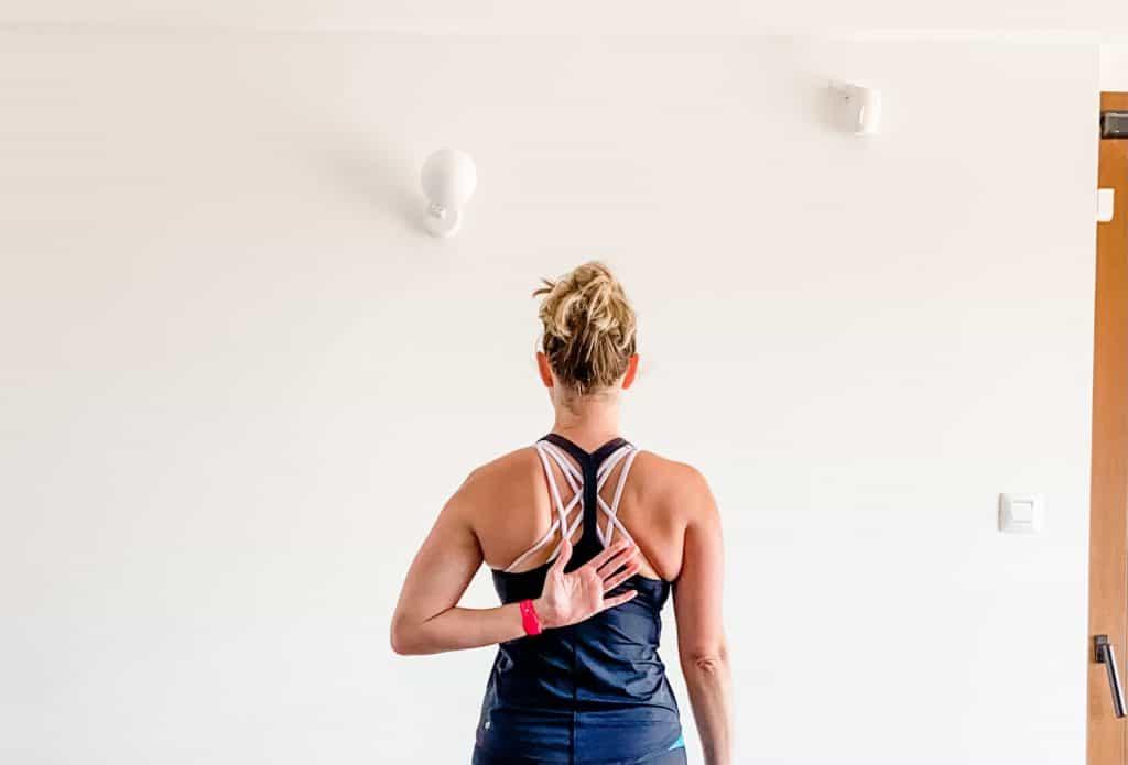 woman demonstrating shoulder internal rotation motion