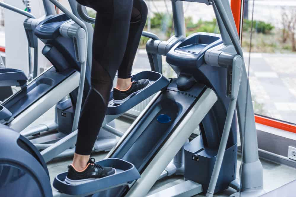picture of a woman's feet on an elliptical machine