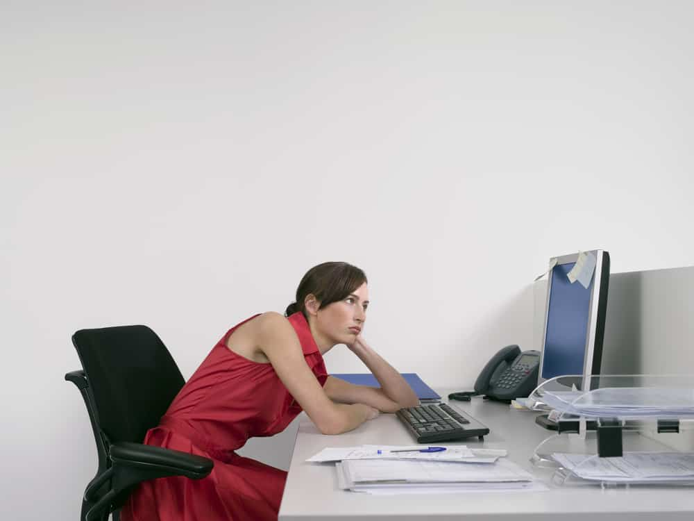 woman slouching at her desk