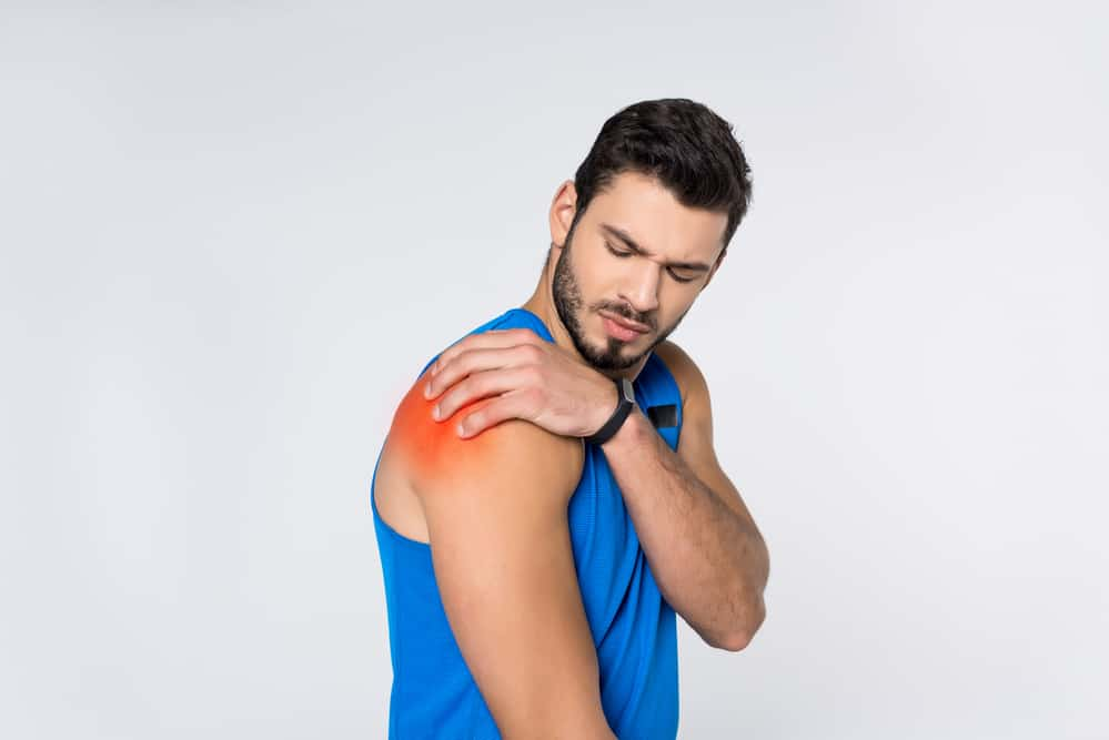 man working out with shoulder pain - exercises to avoid with a rotator cuff injury