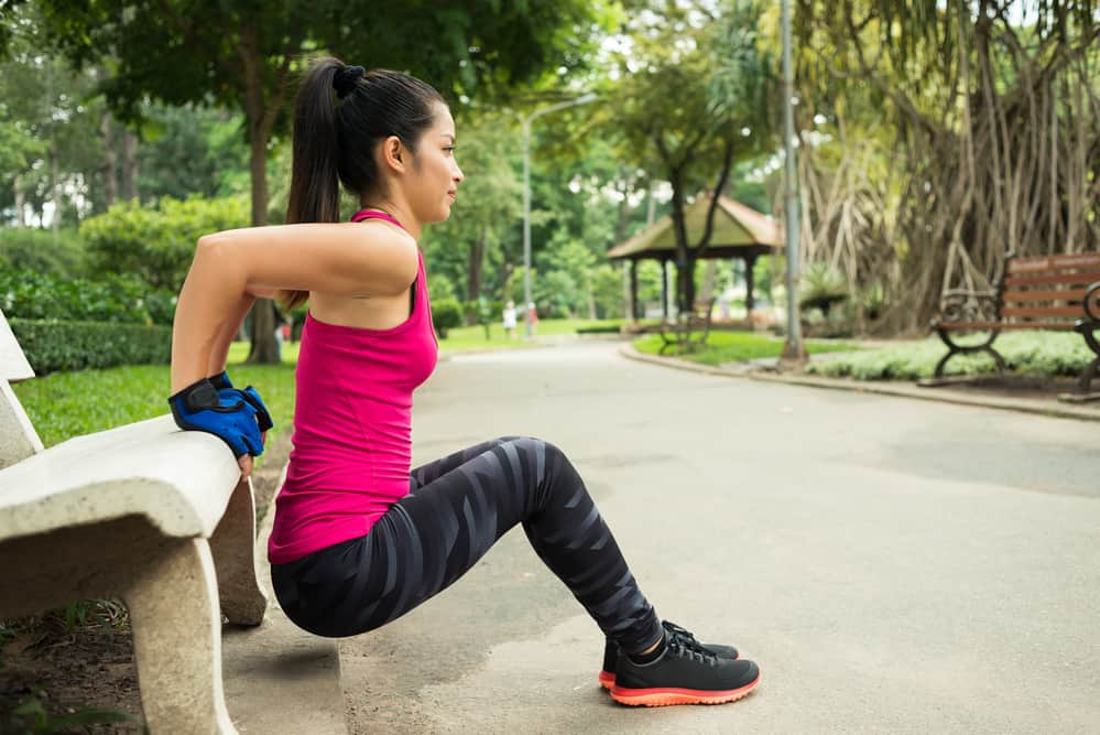 woman doing triceps dips