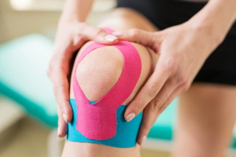 woman with kinesiology tape on her knee